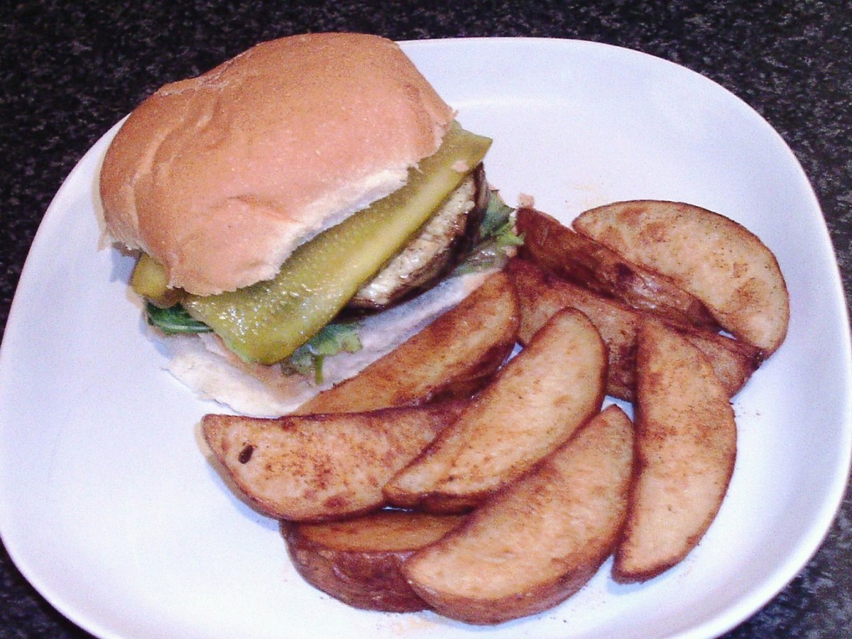Cheese stuffed mushroom is served as a burger with salad, pickles and spicy deep fried potato wedges