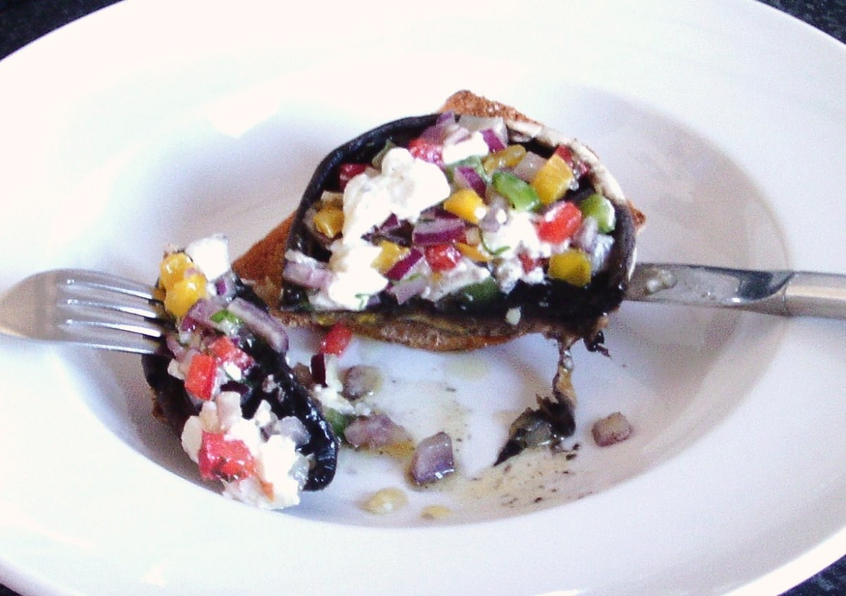 Enjoying salsa and mozzarella stuffed mushroom with bruschetta