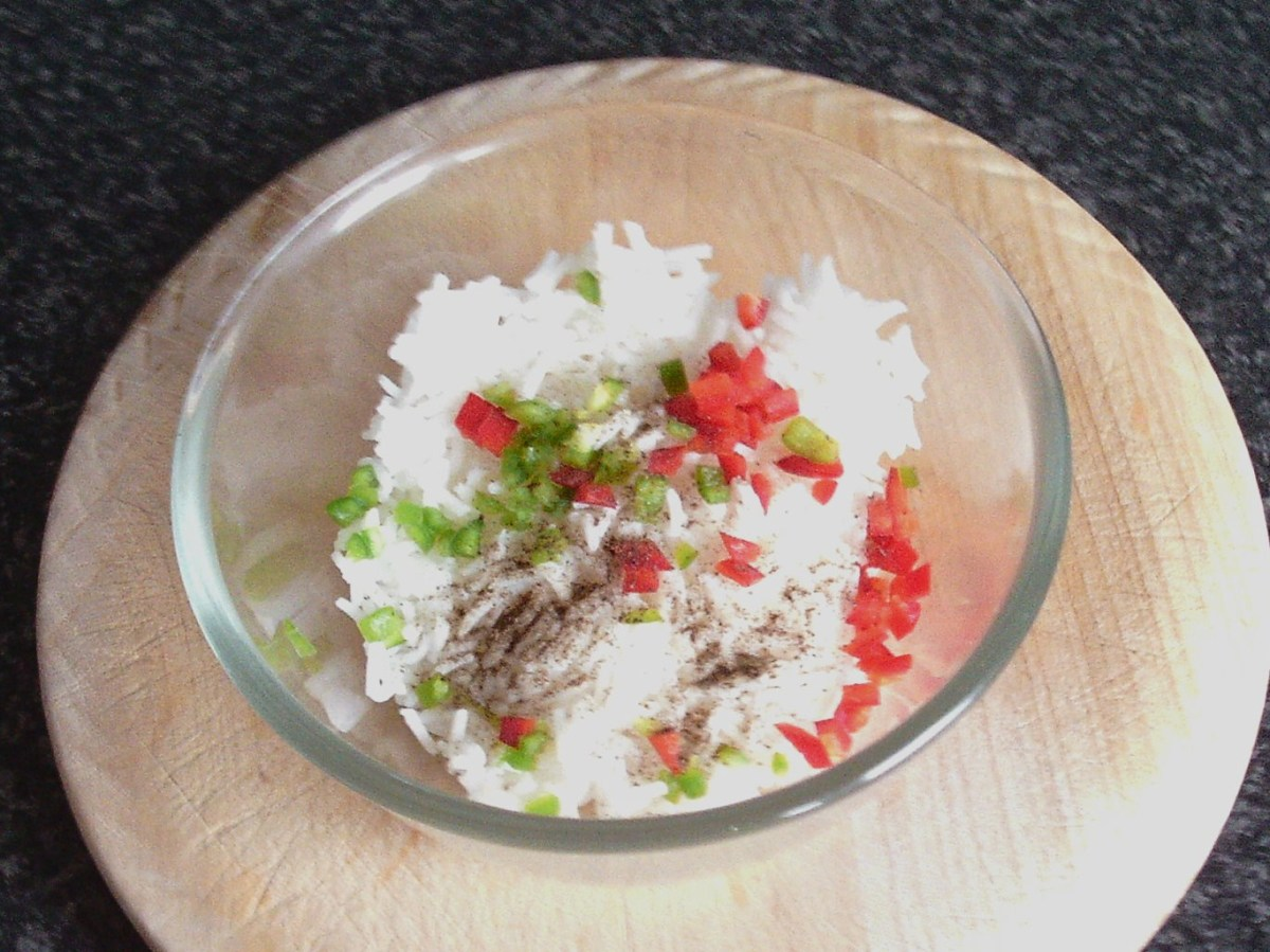 Rice, garlic and seasoning is added to cooled rice