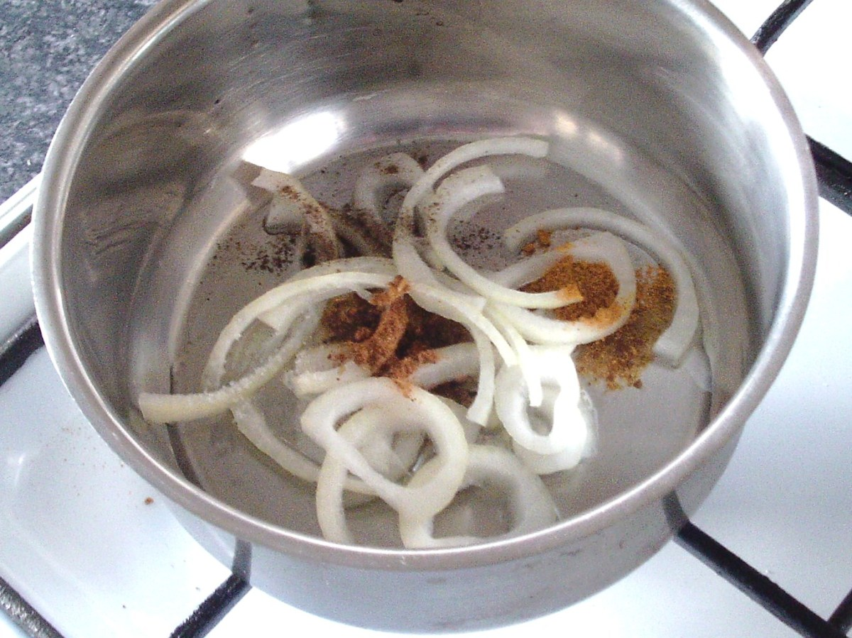 Onion and seasonings are added to pot with oil