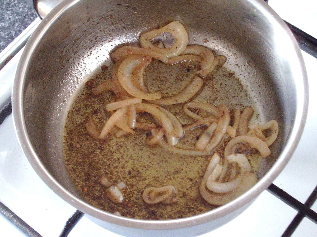 Onions are briefly sauteed in spiced oil