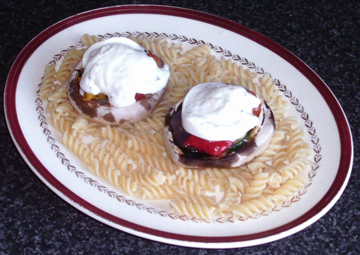 Stuffed mushrooms are laid on pasta bed