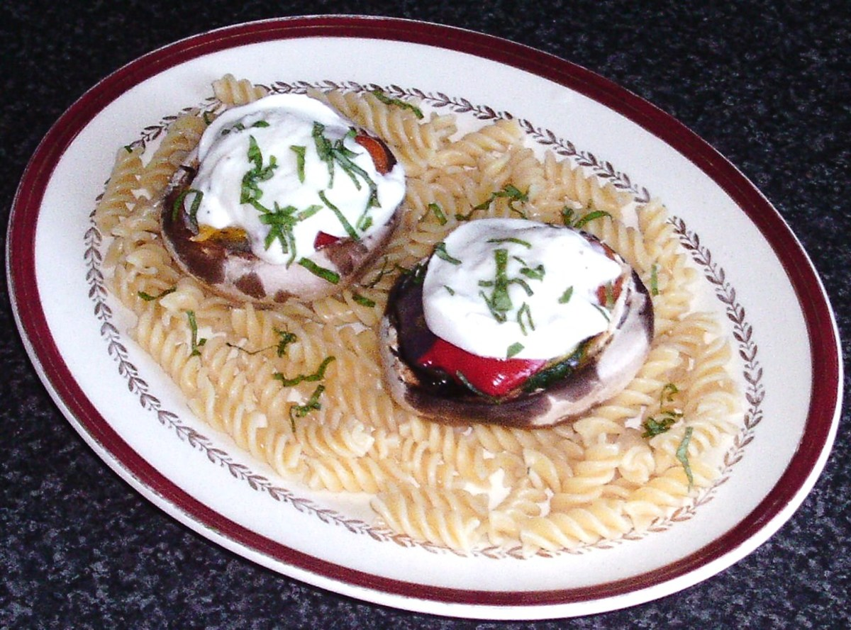 Mushrooms stuffed with mixed roasted vegetables, topped with buffalo mozzarella and served on a bed of pasta