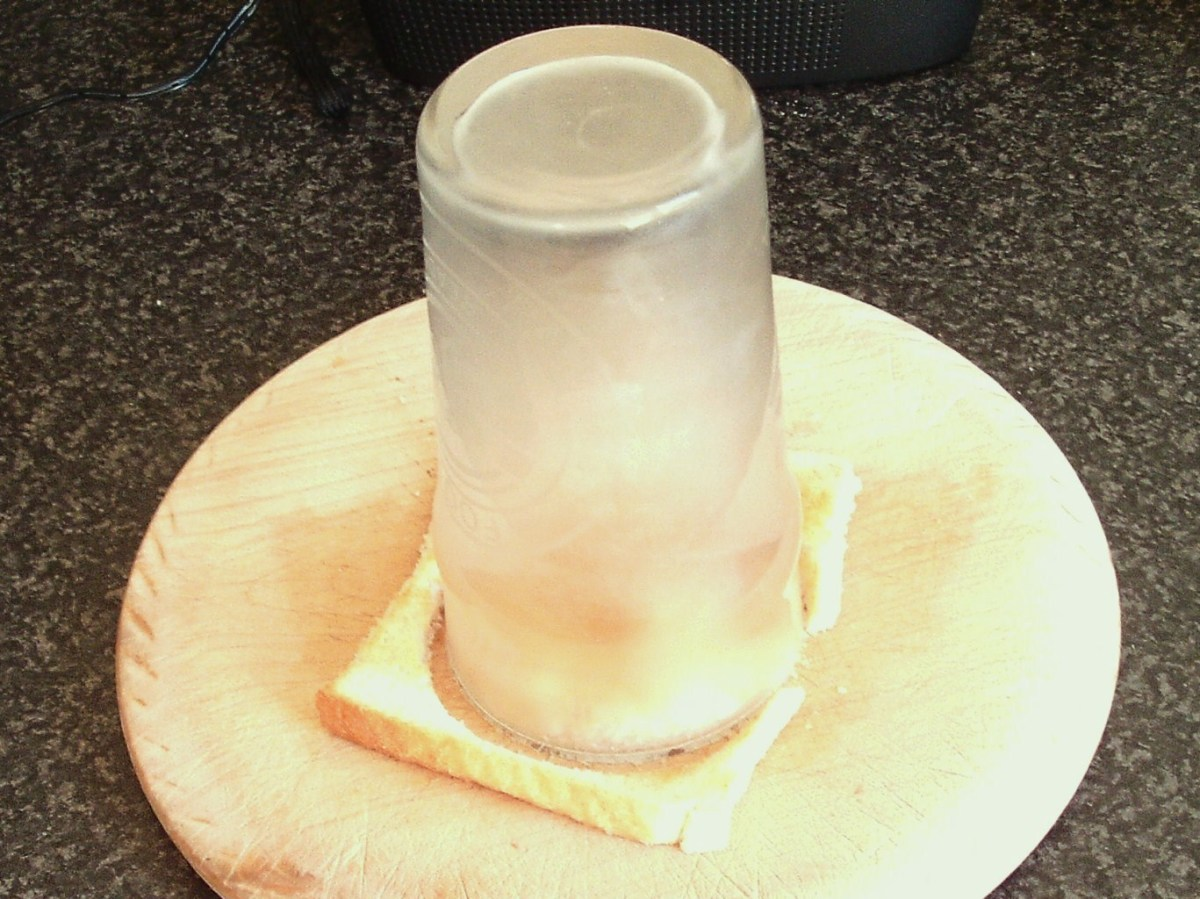 Cutting circle from toast with large drinking glass