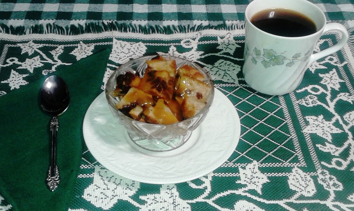 The bread pudding has been cut into cubes and drizzled with caramel sauce.