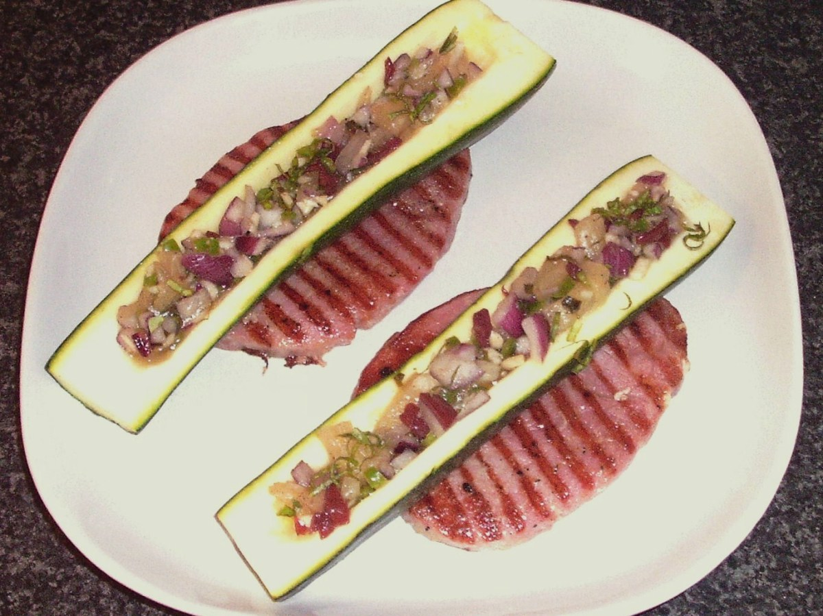Pineapple salsa stuffed zucchini halves served on griddled gammon steaks.