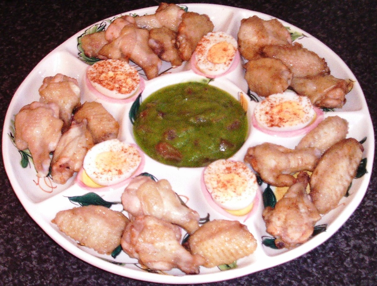 Cooled chicken wings are arranged on serving plate