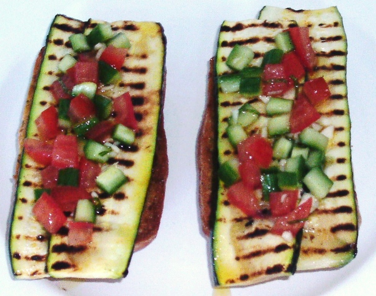 Salsa is spooned on to zucchini bruschetta
