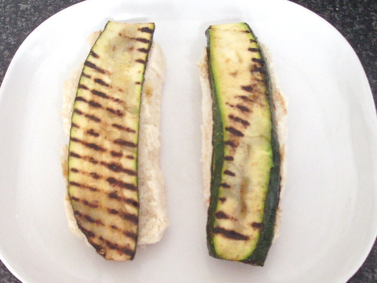 Griddled zucchini slices laid on roll bottoms