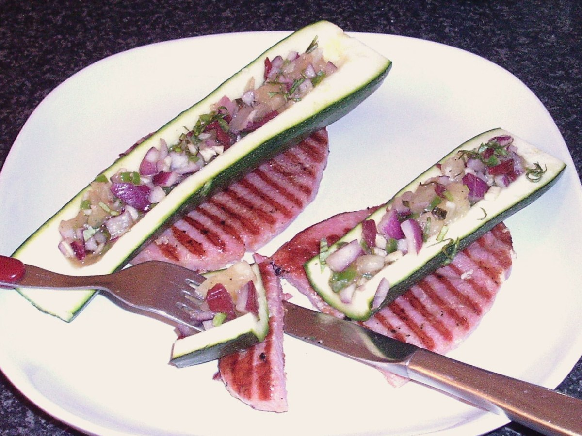 Enjoying pineapple salsa stuffed zucchini boats with gammon steaks