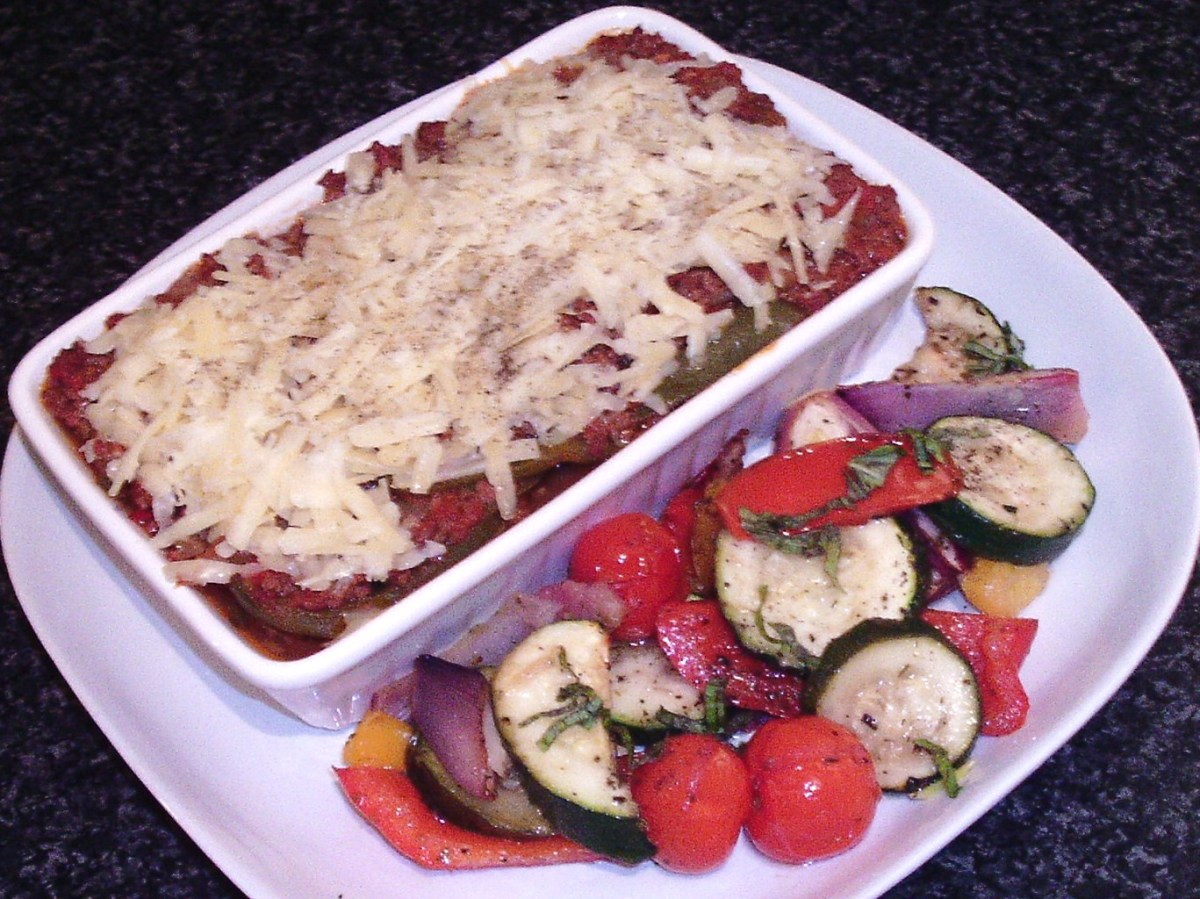 Sliced zucchini are baked with spicy beef and served with roasted fresh Mediterranean vegetables.