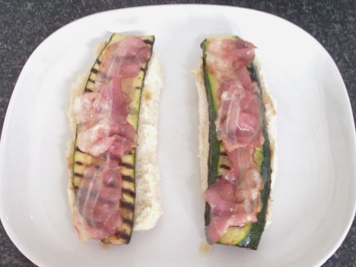Pancetta is laid on zucchini slices