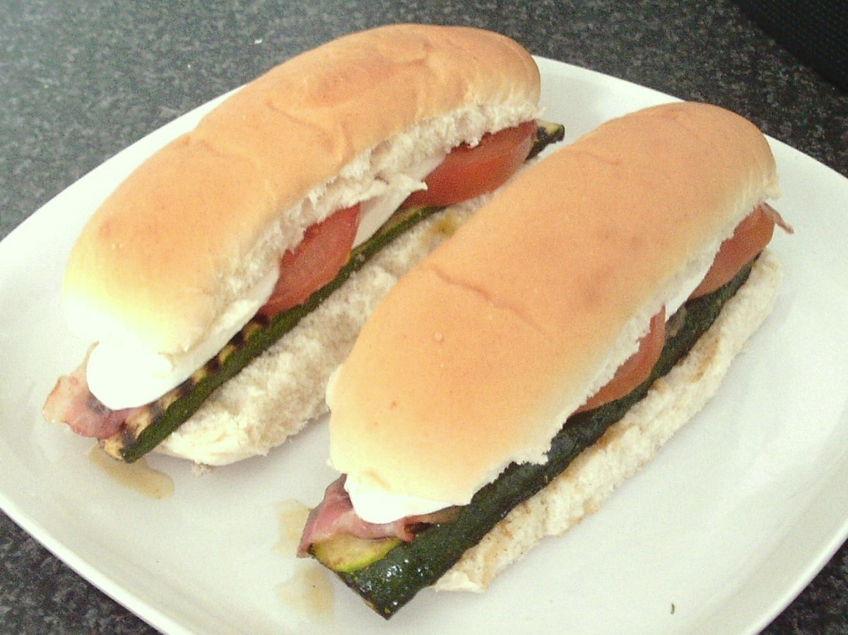 Griddled zucchini slices with pancetta and mozzarella on sub rolls.