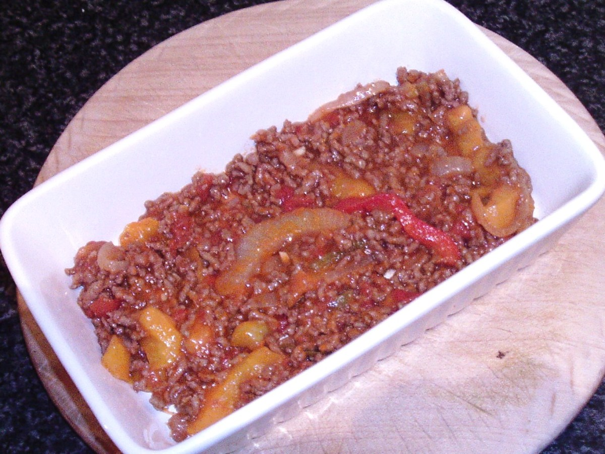 A layer of spicy beef is spread in roasting dish
