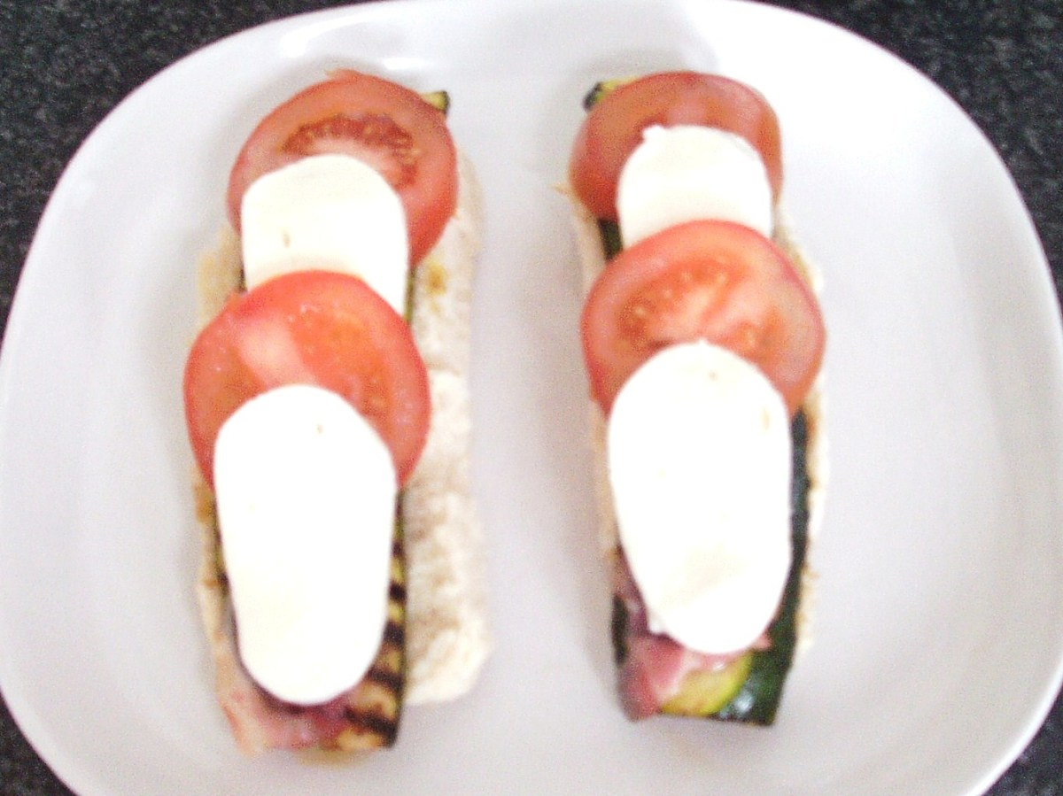 Mozzarella and tomato slices are laid alternately on pancetta