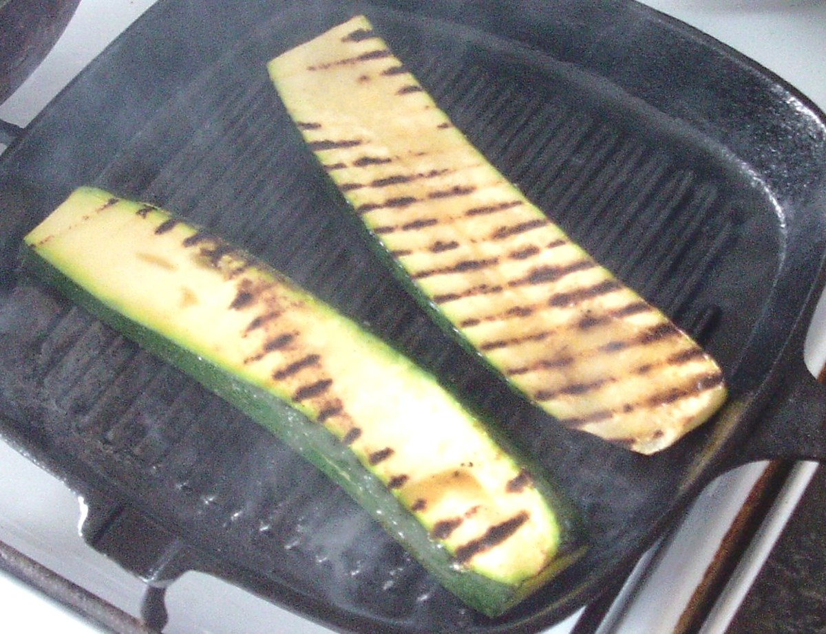 Zucchini slices are turned in griddle pan