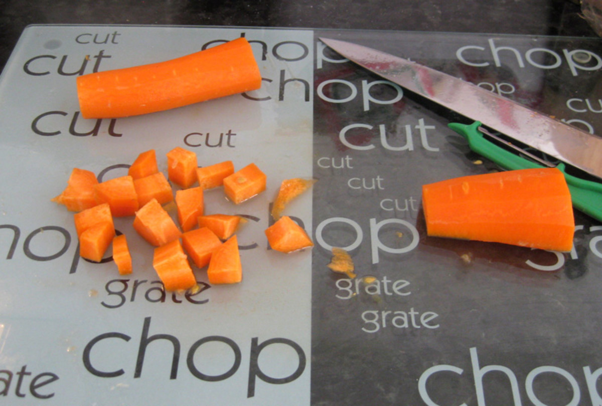 Chopping the carrot.