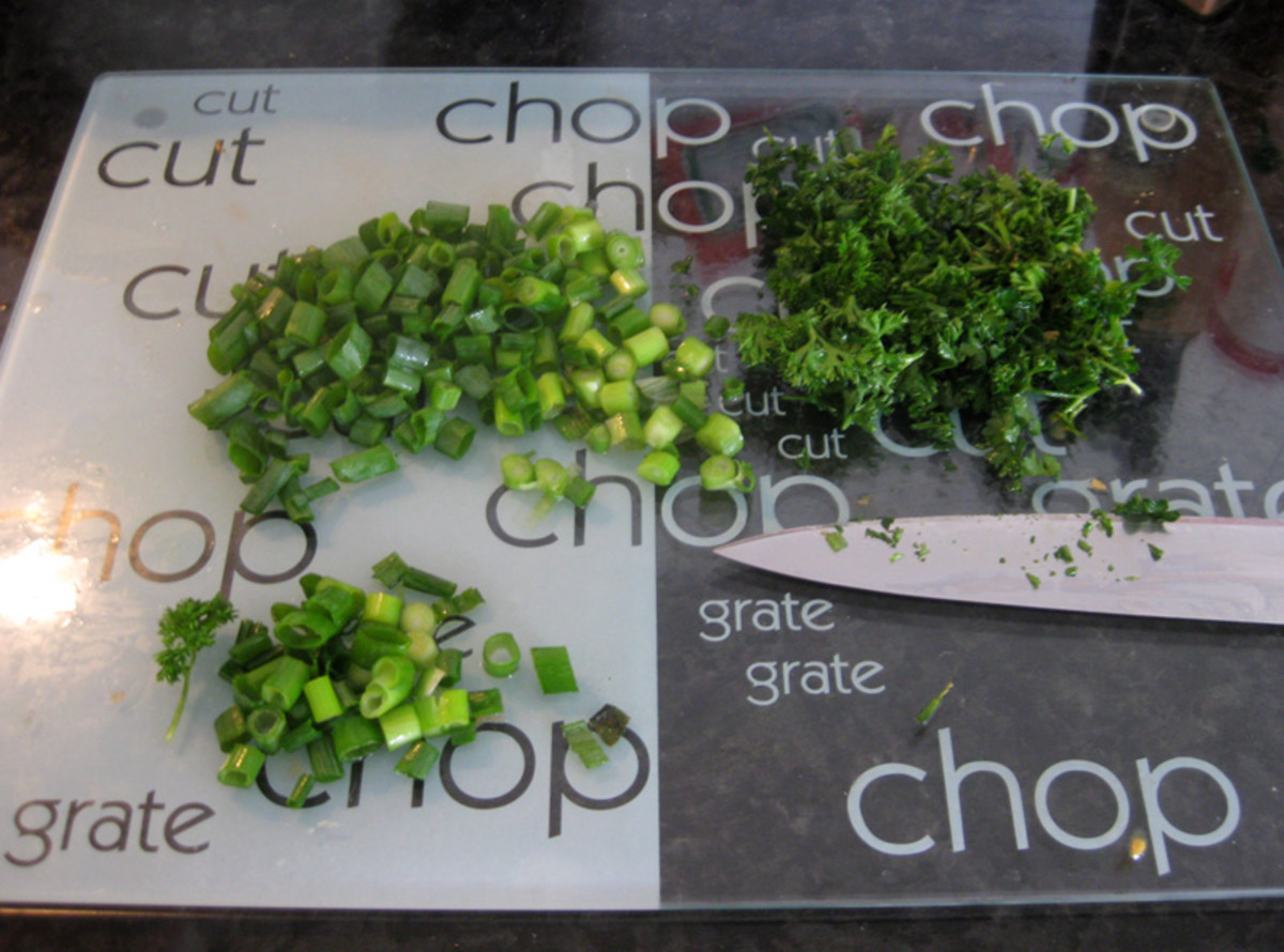 Chop up spring onions and parsley and save a little for a garnish.