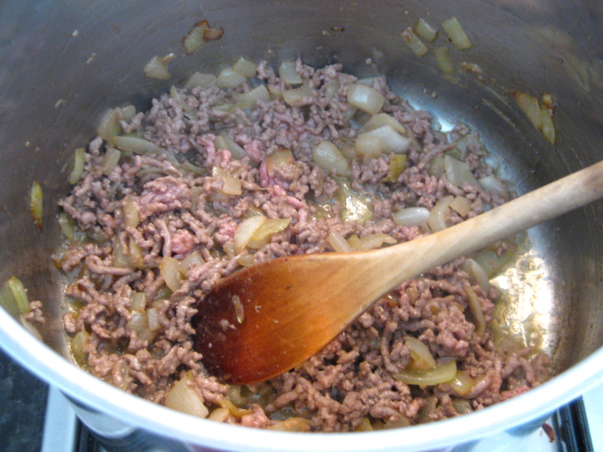 Browning the minced meat.