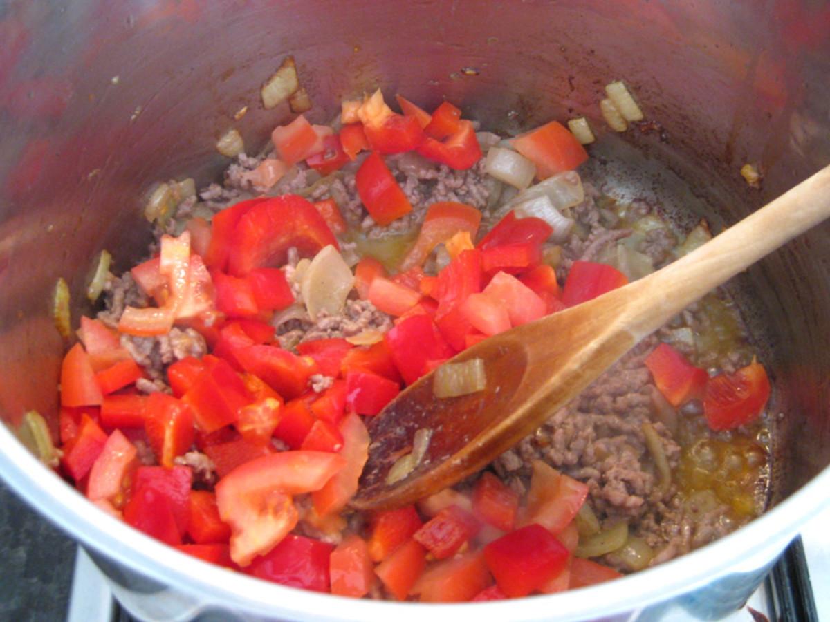 Adding capsicum and tomato.