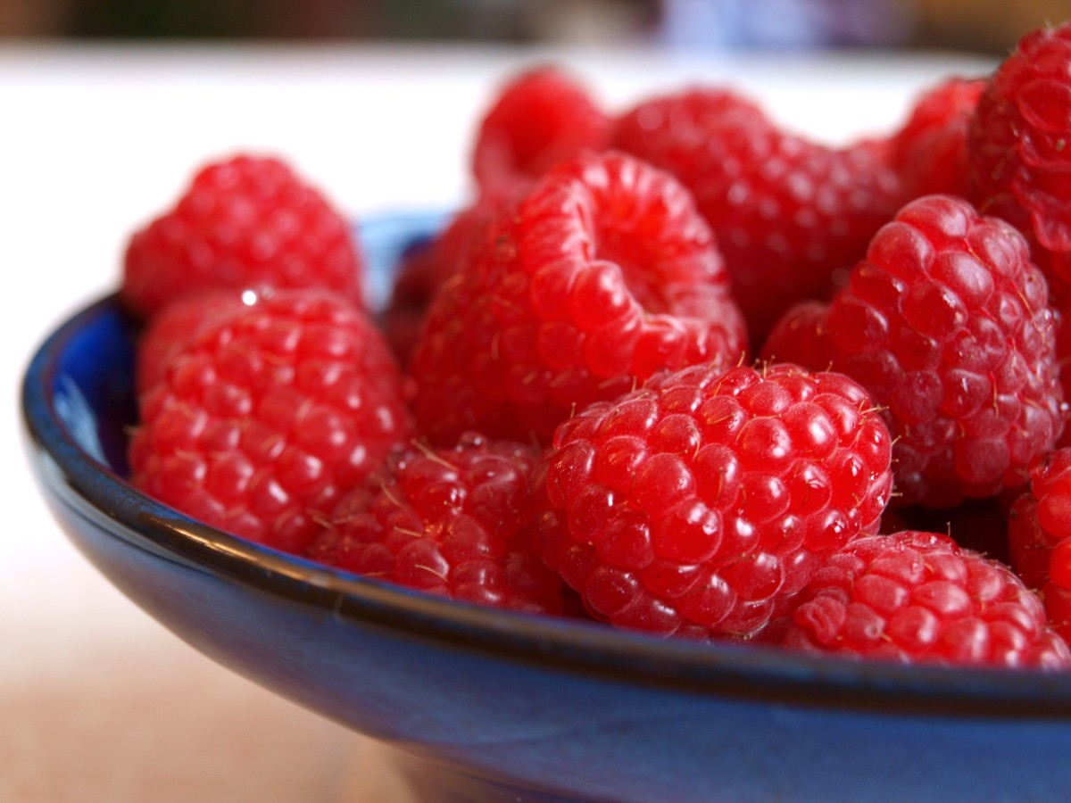 Freezing your summer crop of raspberries lets you enjoy them throughout the year.