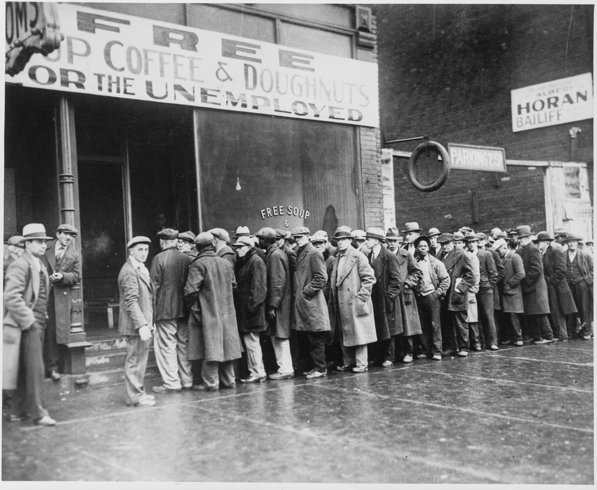 People lining up for free coffee and donuts.
