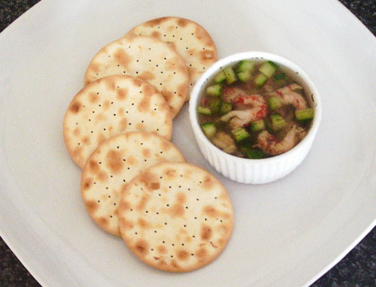 Cucumber and dill potted crayfish tails are served simply with water biscuit crackers