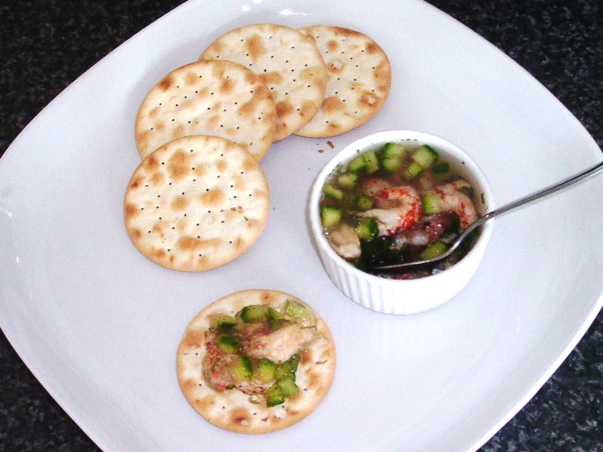 Cucumber and dill potted crayfish tails are spooned on to water biscuits