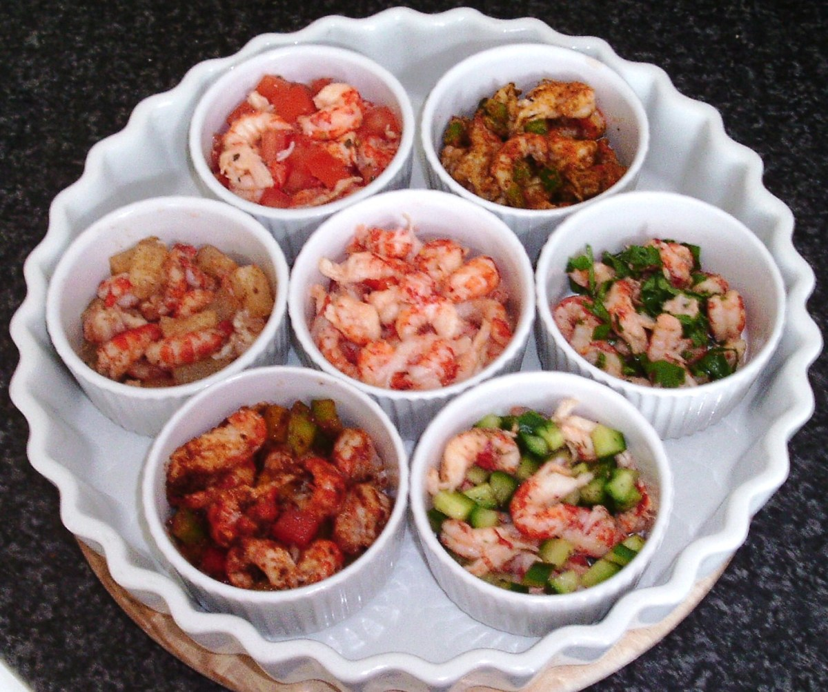 Assembled crayfish tails with assorted flavourants in ramekins