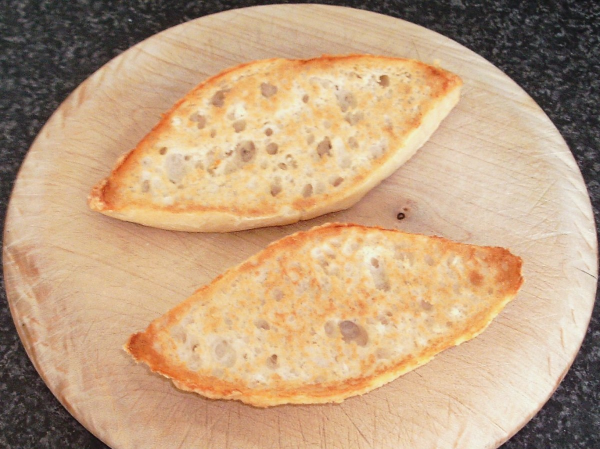 Toasted cheesy bread roll halves