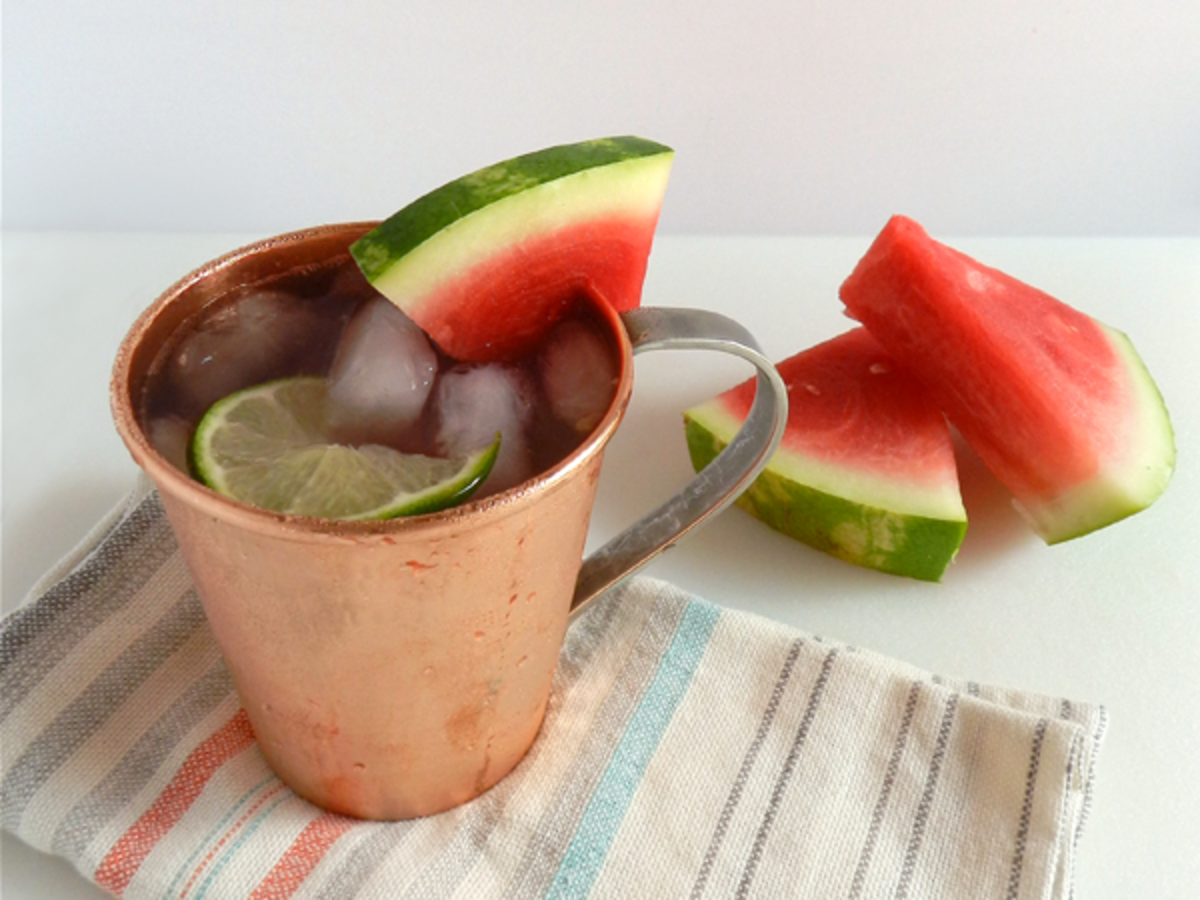 Watermelon Moscow mule, finished with a Moscow mule glass and a slice of fresh watermelon.