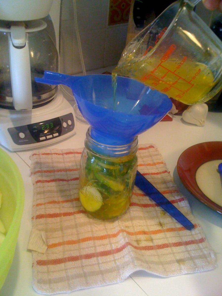 Filling jar with hot liquid.