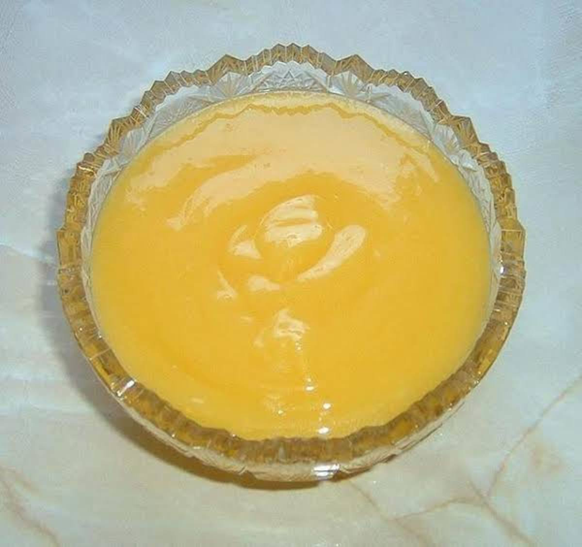 cooked lemon filling is ready to pour into prepared pie crust