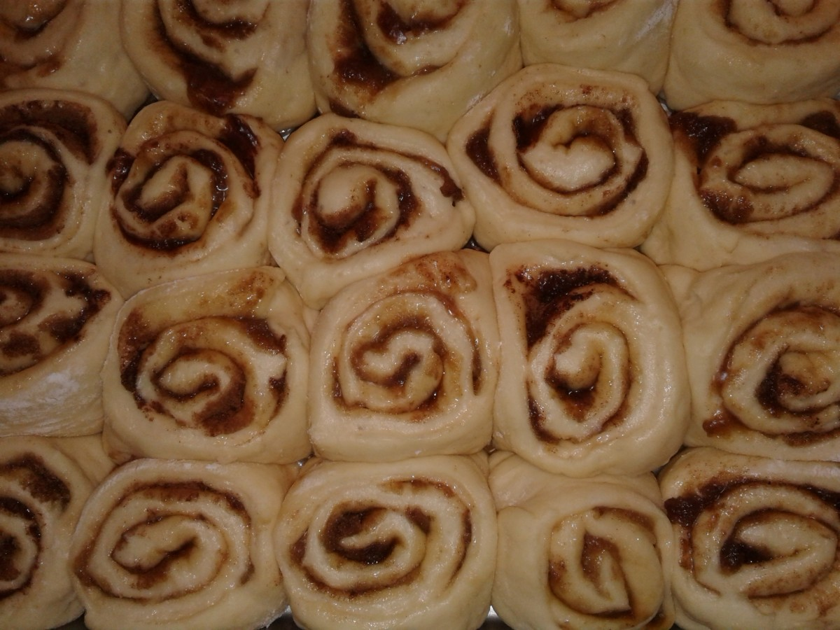 Puffy, risen cinnamon rolls ready to be baked
