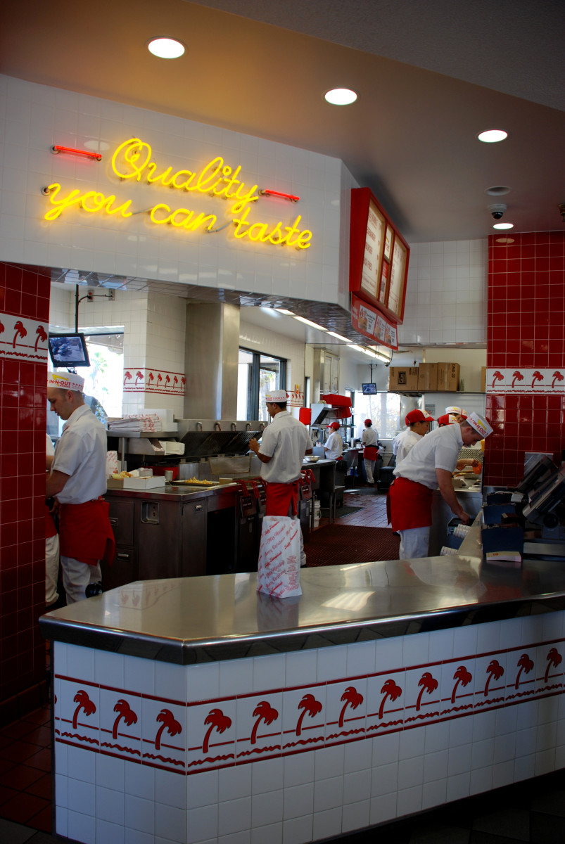 """The busy INO """"stand"""" (kitchen). Typically, there are about 12–14 people working per shift, not including managers.  Busier/quieter shifts require more/less associates."""