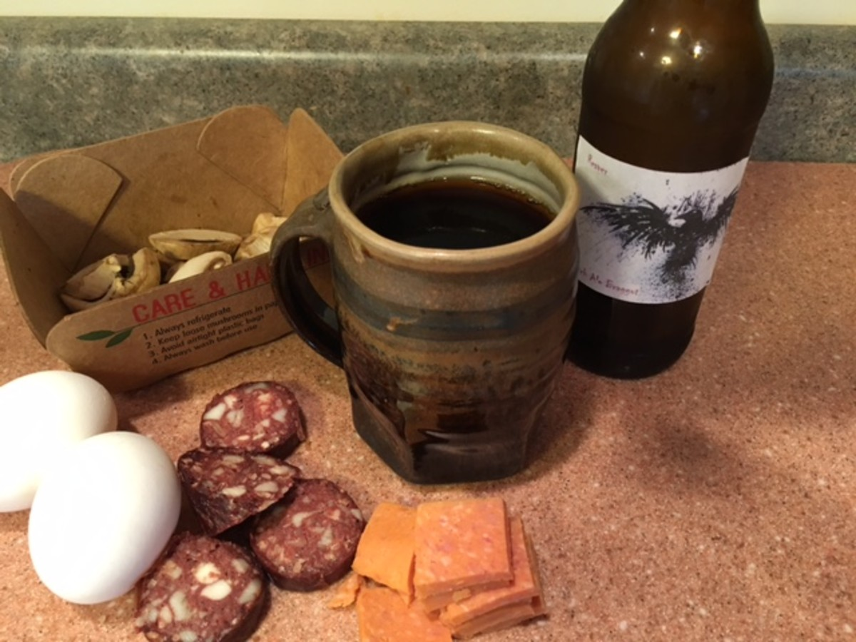 "Some of the raw ingredients for the ""Full American Fry-Up:""  mushrooms, Spam, black pudding, and eggs, plus a home brewed braggot (mead with Scotch ale grains)."
