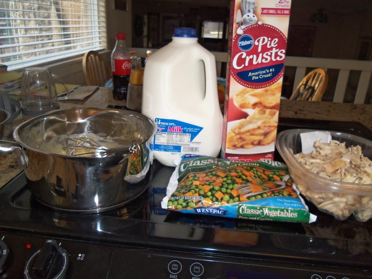 Pre-prepared pie crusts, milk, frozen peas and carrots, butter, chicken, flour, and chicken broth