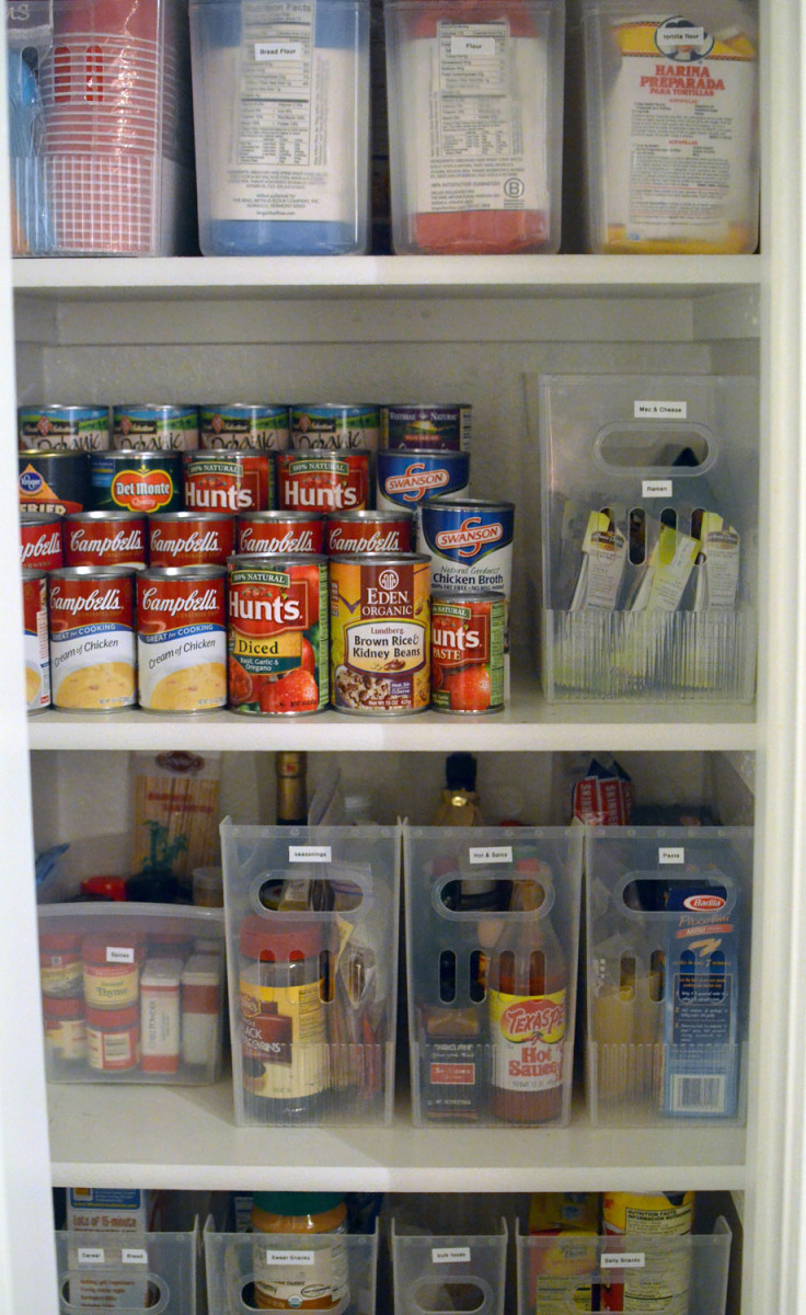A tiered cabinet organizer makes it simple for these homeowners to find the cans that they need quickly and easily.