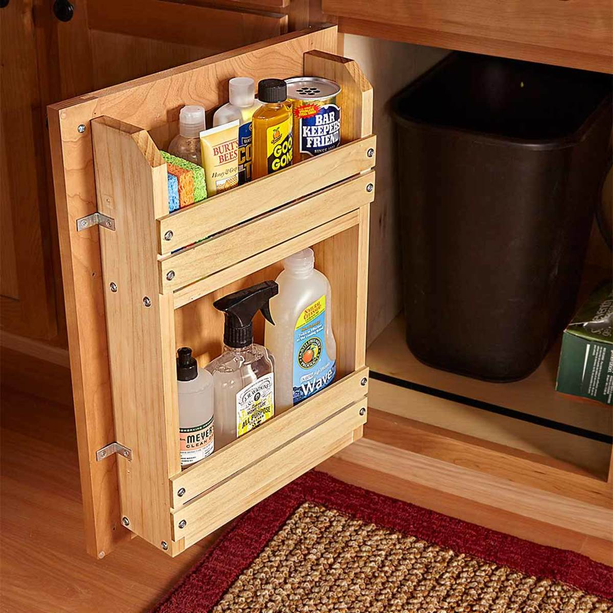 This simple wooden cabinet door storage rack frees up valuable under the sink storage while offering easy access to frequently used cleaning supplies.