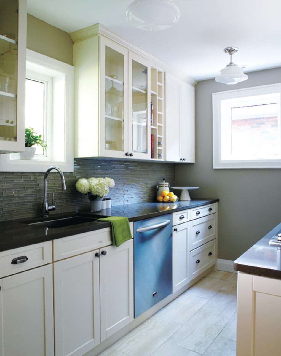 With a few carefully selected items on the counter, this galley kitchen feels very clean and open.