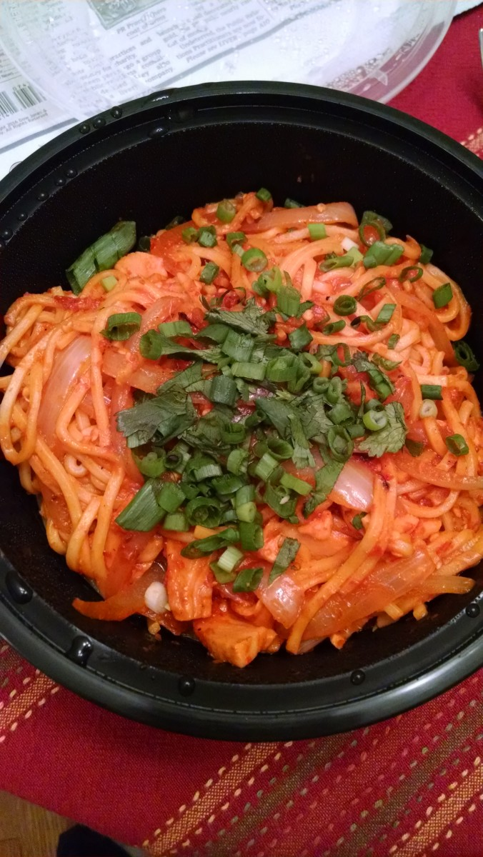 House-cured salmon pancit, with sweet pepper, onion, calamansi, house-made sriracha, and cilantro.
