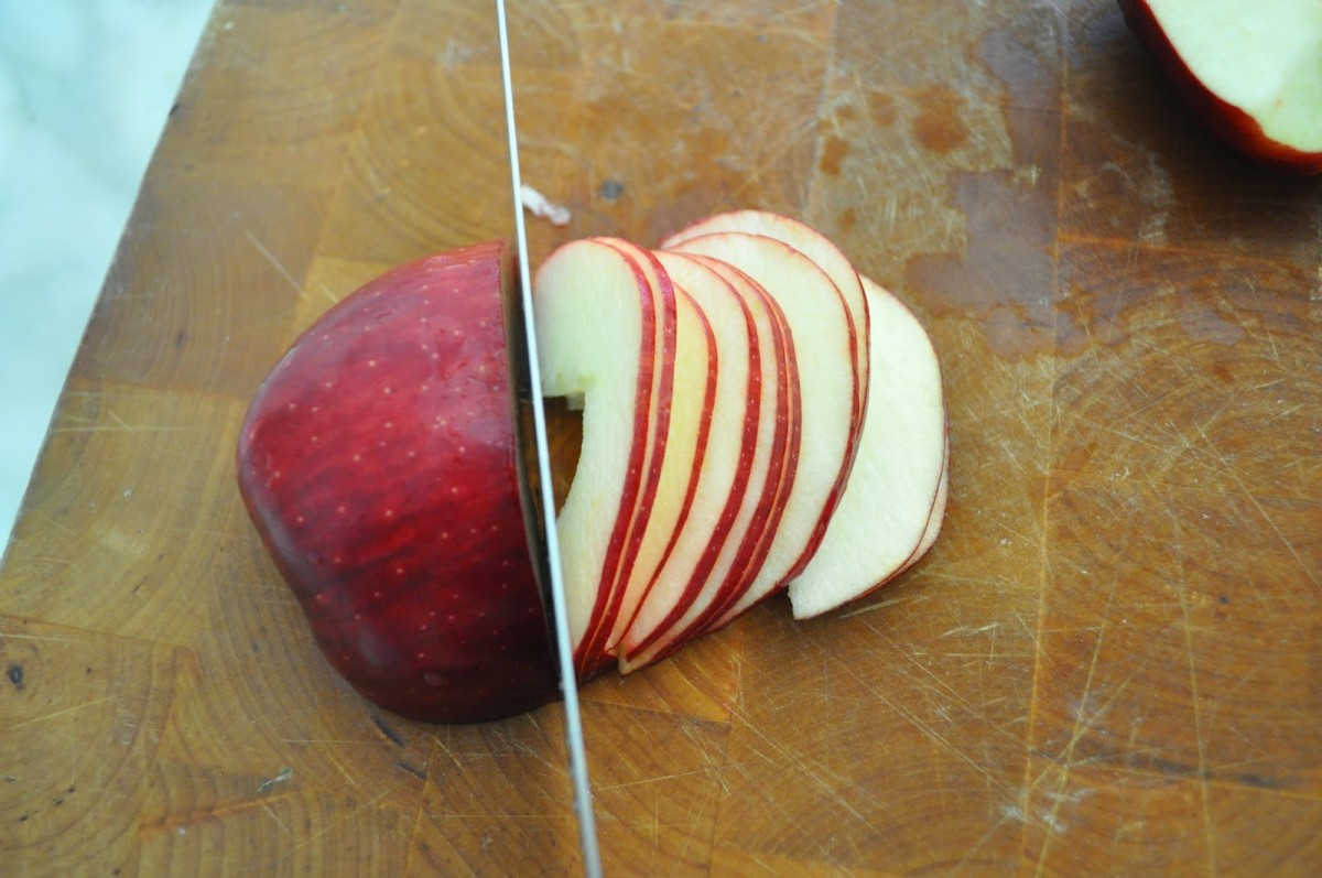 Slice the apple from the top end towards the bottom