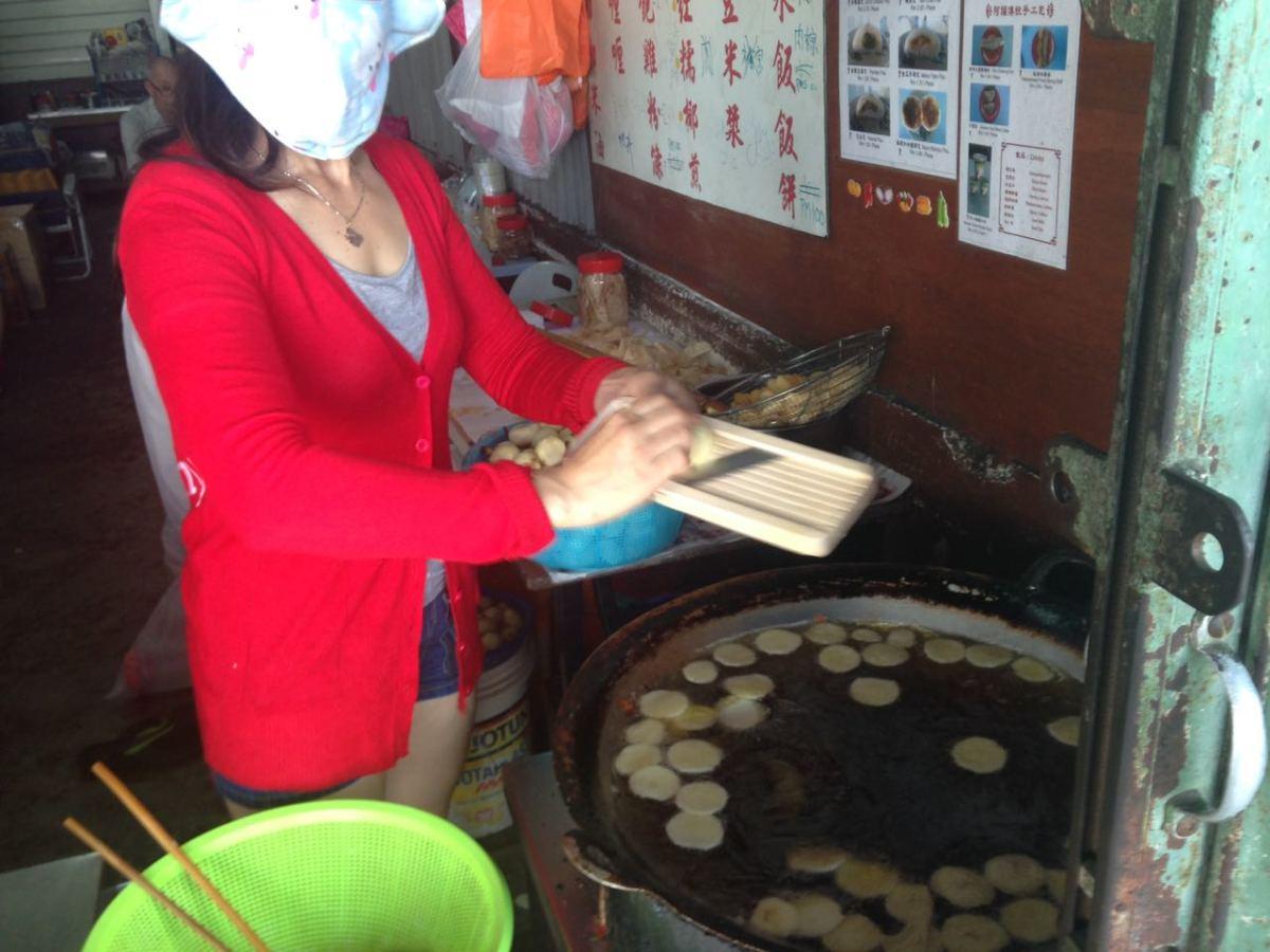 Frying arrowhead chips In a large kuali (wok)