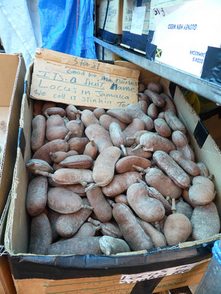 A box of stinking toe fruit for sale.