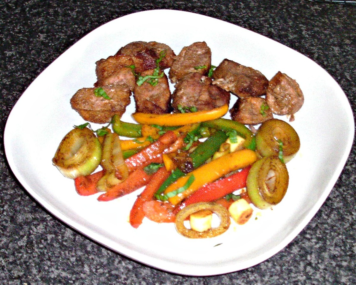 Spicy pork shish kebab meat served with spicy sauteed bell peppers and leek