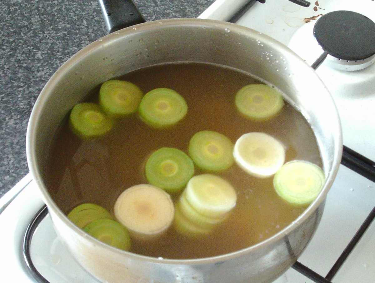 Leek stem and potato are added to strained lamb stock