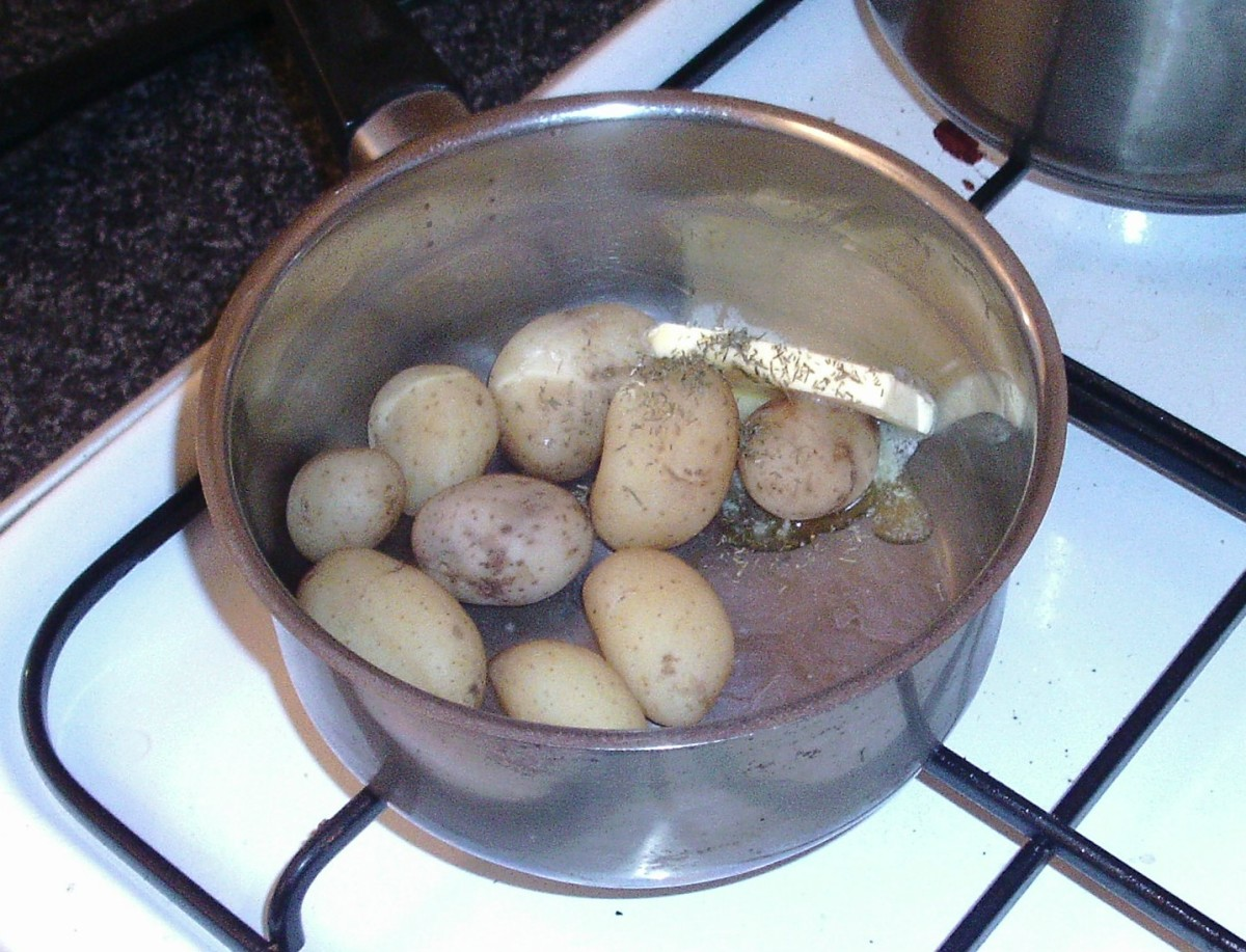 Butter and dill are added to potatoes