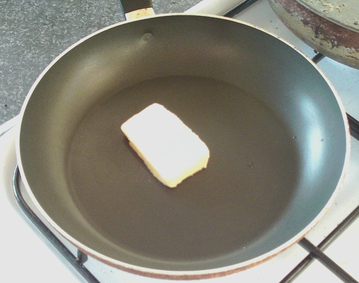 Butter is melted in frying pan