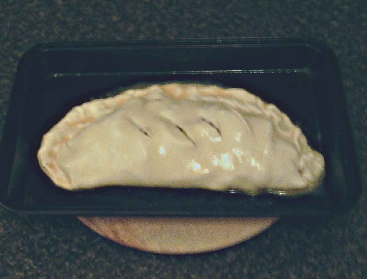 Crimped and glazed pasty is ready for the oven