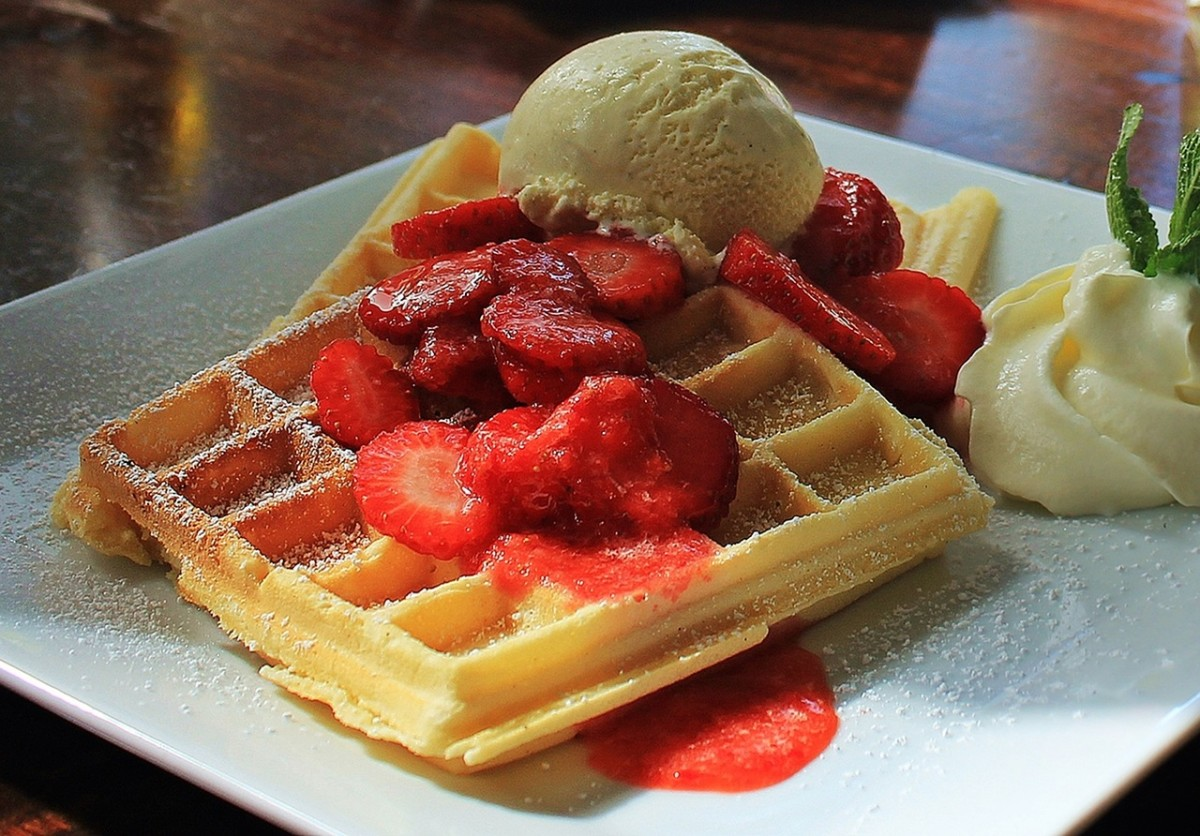 Waffles with strawberries and confectioner's sugar.
